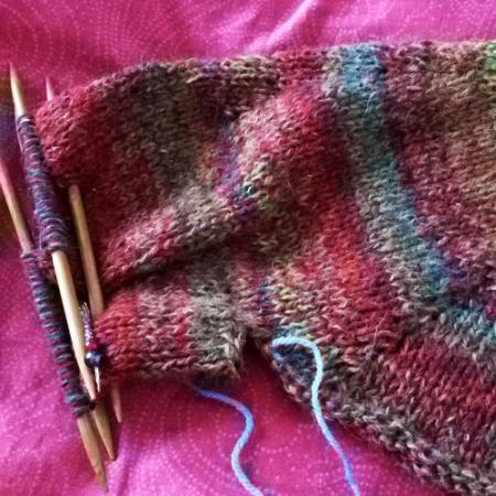 Una manica spunta dal maglione
